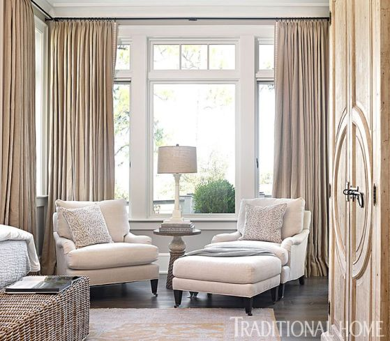 Traditional Home Upholstered Ivory Fabric Chairs with Ottoman in Bedroom Sitting Area In Front Of Linen Drape Panels