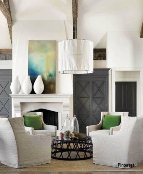 Gray Tall Cabinets Flanking Fireplace, Living Room with Linen Chairs and Green Pillows