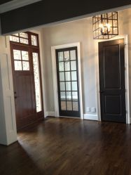 Walnut Wood Flooring, Pale Gray Wall Color, Iron Lantern, Craftsman Architecture