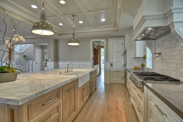Kitchen with Washed Oak and White Cabinets , Schoolhouse Chrome Pendants, Gas Range with Wood Hood