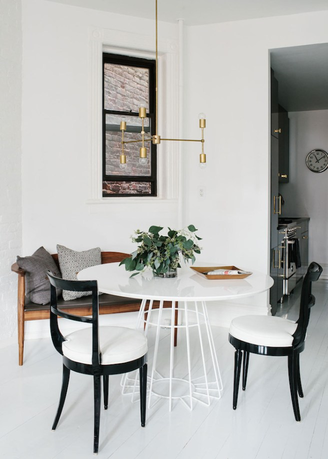 White Painted Wood Floor, White Wire Leg Breakfast Table, Black Lacquered Chairs, Gold Light Fixture, Black Painted Window Sashes