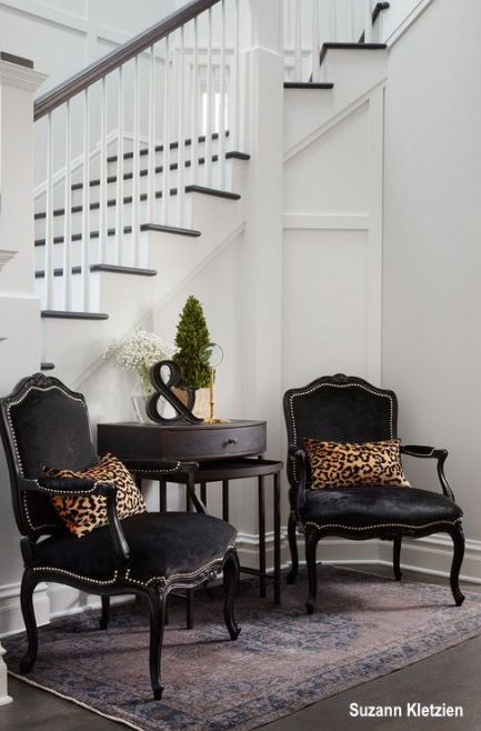 Dark Velvet Arm Chairs in White Paneled Foyer on Persian Area Rug