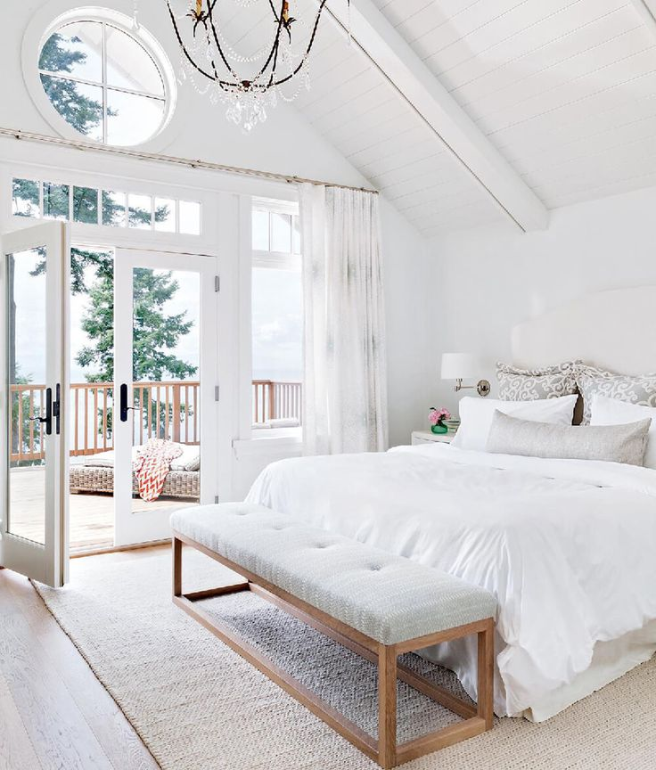 White Bedroom with Glass Doors Onto Mountain View Deck -pinterest