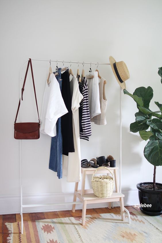 Need more closet space? How about a simple white garment rack with a weeks worth of clothing, shoes, handbag and accessories -via stylebee