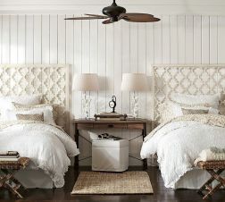 Wood paneled bedroom wall with twin lattice work headboards, shared vanity as night stand, pair of lamps - pinterest