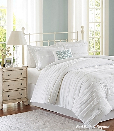Bed Bath & Beyond White Iron Bed with White Cotton Linens, White Washed Night Stand in Soft Blue Painted Room