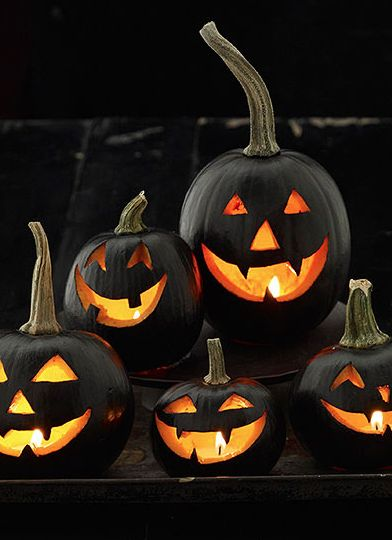 A Pile of Happy Black Jack O Lanterns via Pintrest
