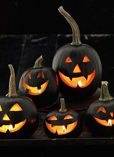 A Pile of Happy Black Jack O Lanterns via Pintrest