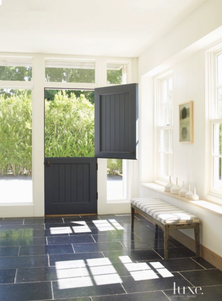 Slate Floor Entry with Charcoal Bead Board Dutch Doors White Walls With  Golden Sunlight