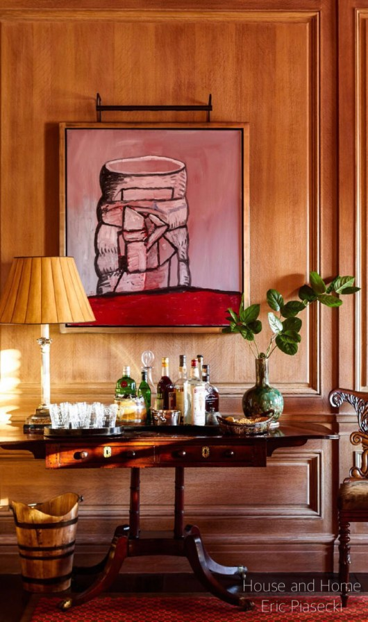 houseandhome eric piasecki wood paneled room with traditional table set up with bar tray