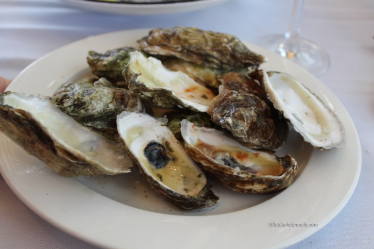littleblackdomicile.com - white plate on white tablecloth with empty oyster shells color inspiration for interior design