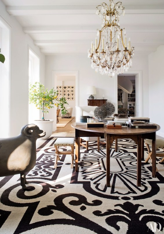 via architectural digest Black and White Rug with Drippy Crystal Chandelier