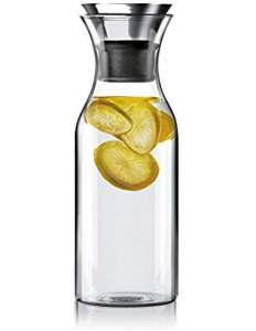 Bedroom water carafe with metal cup and lemons http://amzn.to/2z4s0tn