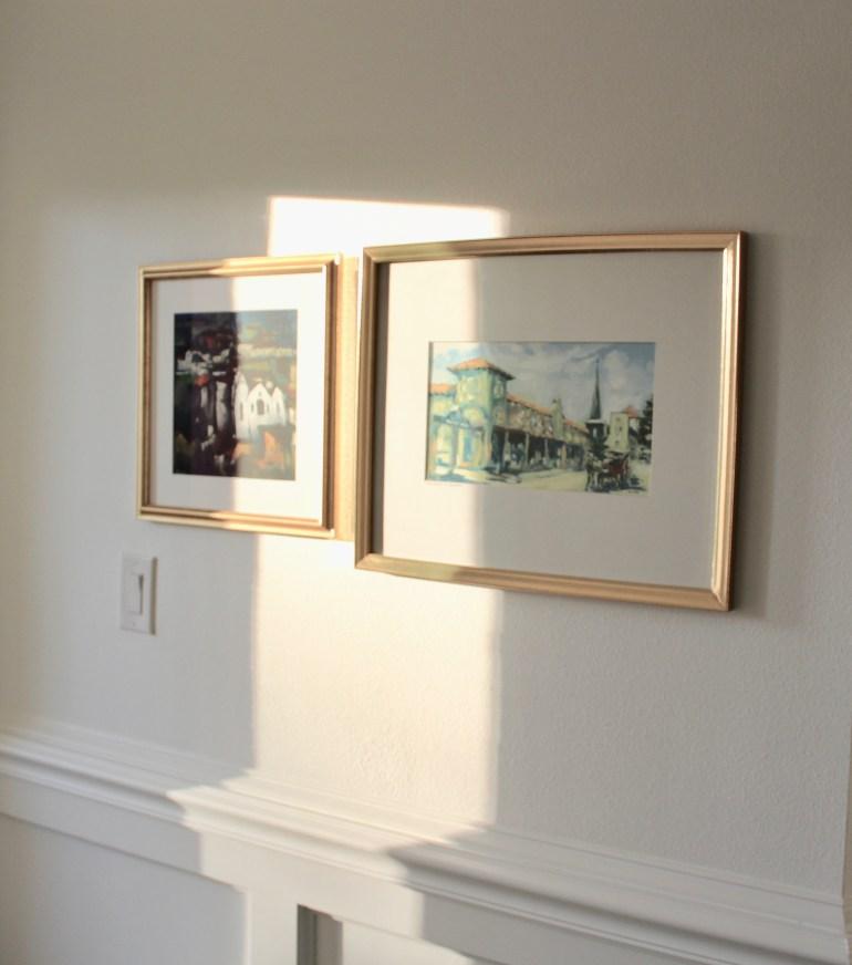 littleblackdomicile.com pair of art in gold frames with sunlight