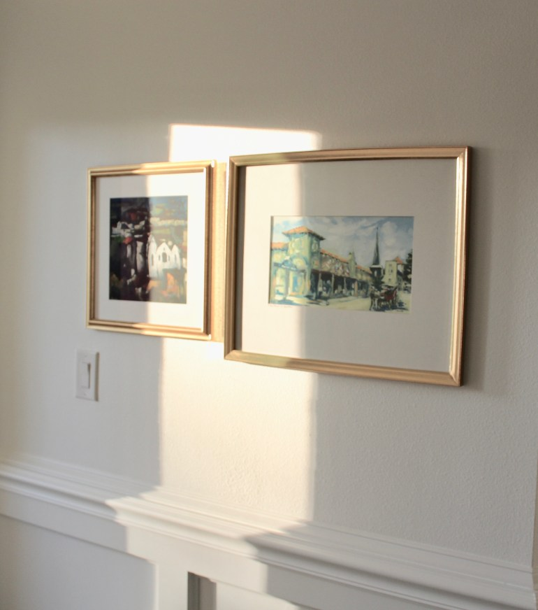 littleblackdomicile.com pair of art in gold frames with sunlight