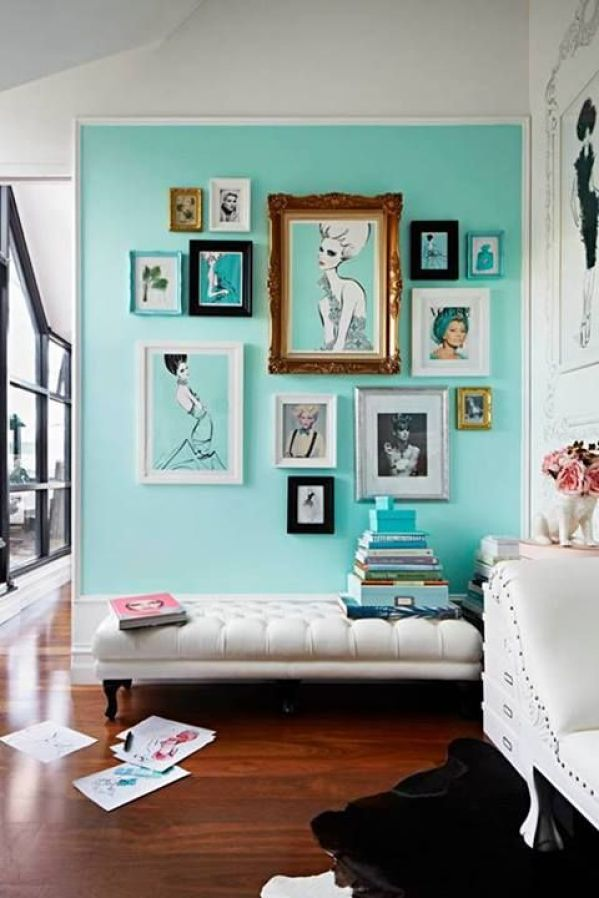 gallery art on turquoise wall via Armelle Habib