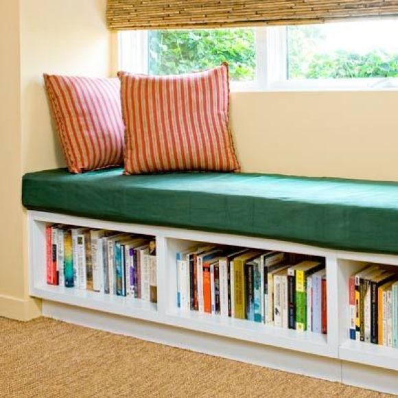 window seat with open shelves for cookbook storage