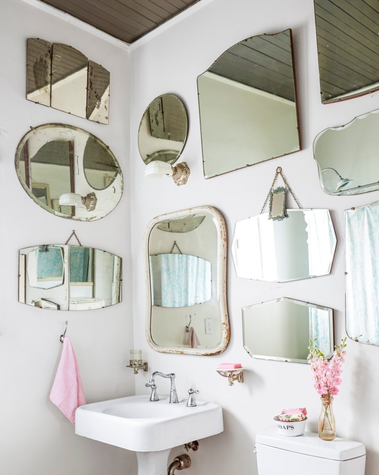 Powder Room With Gallery Wall of Mirrors
