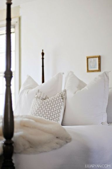bedroom with poster bed, white linens and cream furry throw-via julia ryan