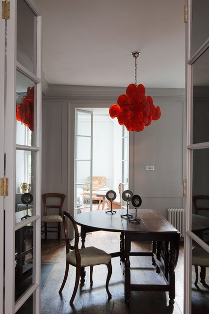 Red chandelier in dining room