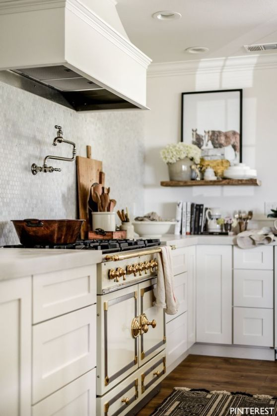 Pinterest creamy range with gold hardware and pot filler