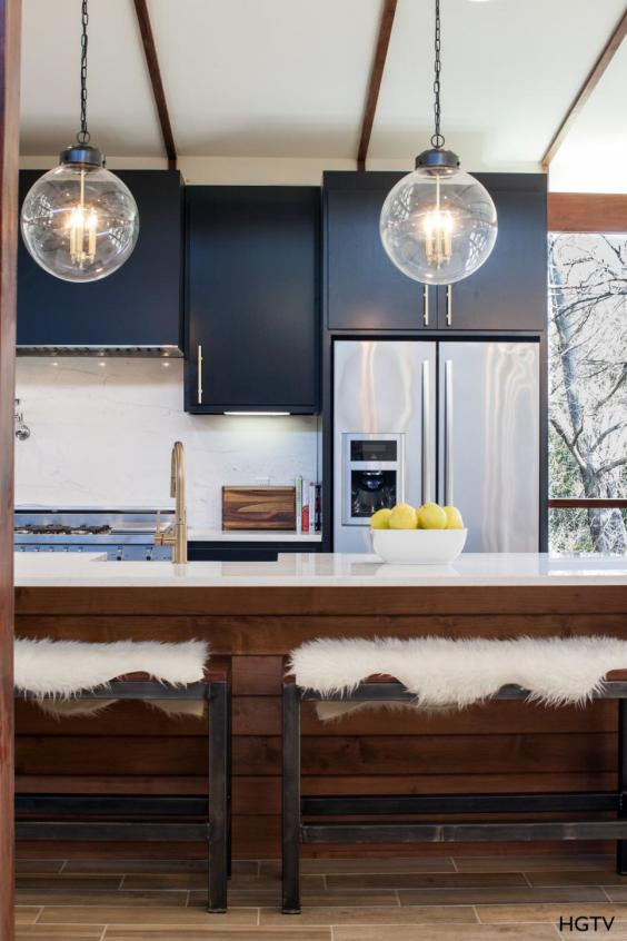 HGTV Navy Kitchen with White Counter Tops and Brass Faucet