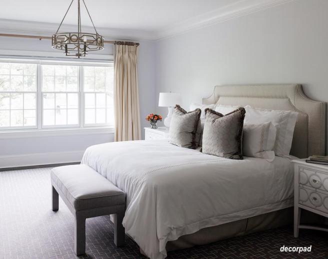 taupe-linen-headboard-pleated-bedskirt-geometric-ring-chandelier via decorpad