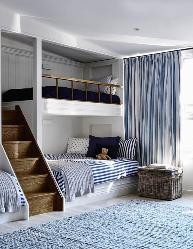 homeswelove built in bunk beds with blue and white stripped linens