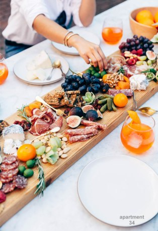 charcuterie-board- on what tablecloth with melon drink apartment 34