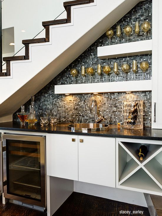 stacey_earley glitz and glam wet bar under staircase