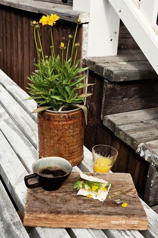 sawmill hostel- yellow flowers-tin can planter- wood cheese boards-orange juice- coffee cups