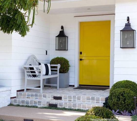 houzzgardenstudio yellow dutch door-white shiplap siding-washed brick porch-black lanterns