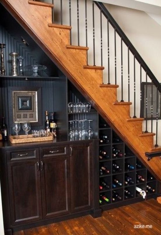 alike.me black cabinets - wet bar-under stairs-iron stair railing-wine storage