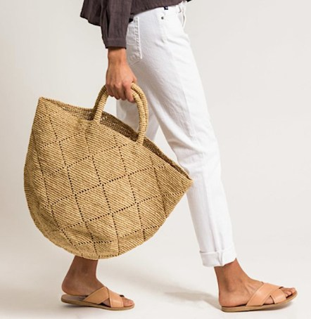 white-jeans-gray-tee shirt-camel candles-woven bag