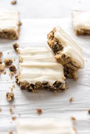 kj&company-frosted-cake bars-on parchment paper