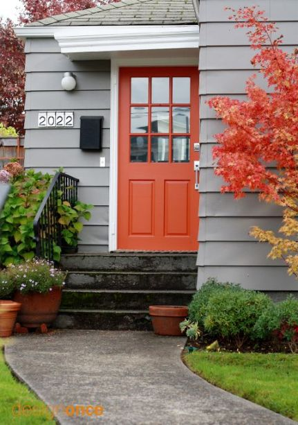 designnonce gray house with cantaloupe colored door