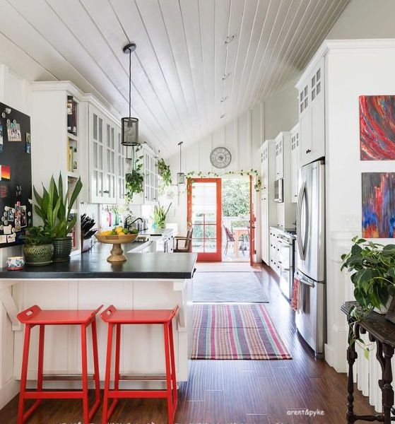 aren't&pyke-white-kitchen-orange-counter -stools-stripe-area-rugs-shiplap-ceiling-slate-countertops-littleblackdomicile-we-spy-sunday