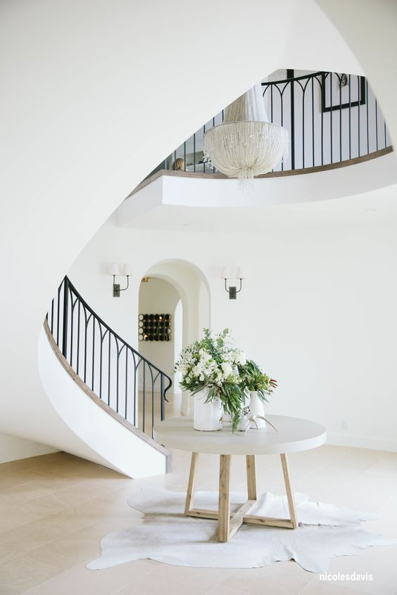nicole-s-davis-curved-staircase-concrete-floor-gothic-stair-rail