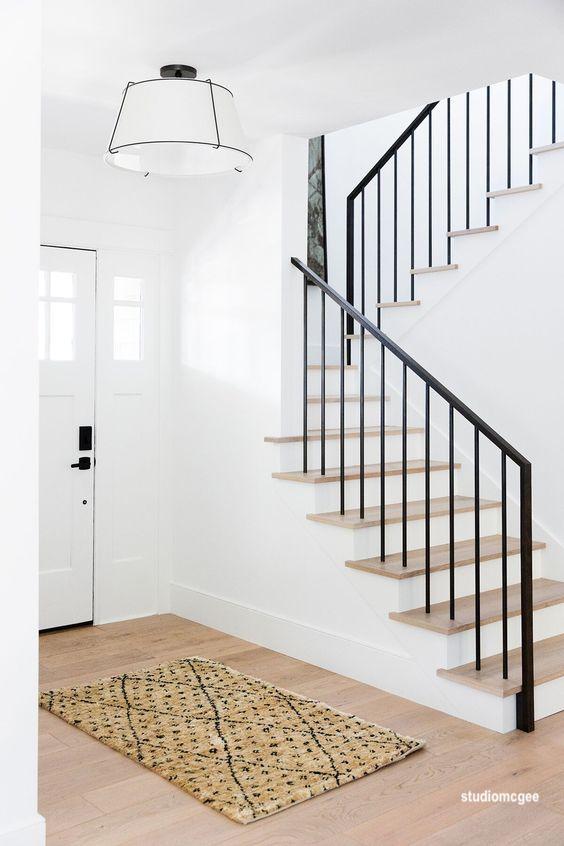 studio-mcgee-natural-wood-floors-iron-stair-rail