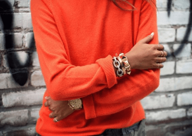 pinterest-orange-cashmere-sweater-gold-bangles