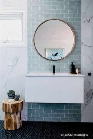 smallkitchendesigns-tile-wall-bathroom-freehanging cabinet-marble-walls-round-mirror