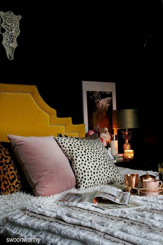 swoon worthy-black bedroom-mustard-headboard-animal-print-pillows