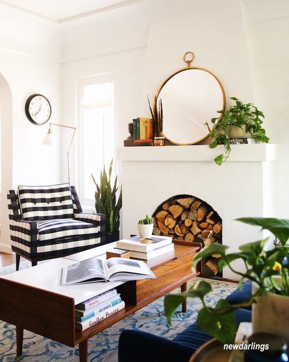 new darlings-white-walls-living-room-black&white-stipe-chair-navy-sofa