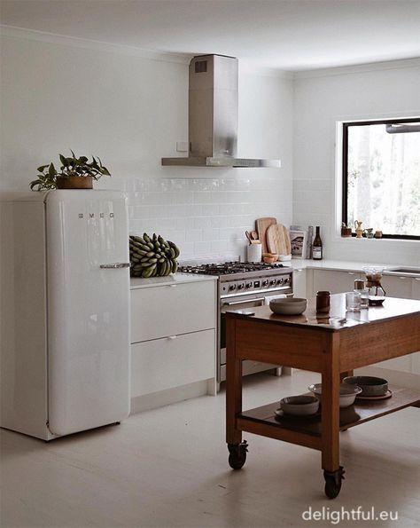 delightful.eu-smeg-refrigerator-white-cabinets-4x4whitetile-stainless-range-hood