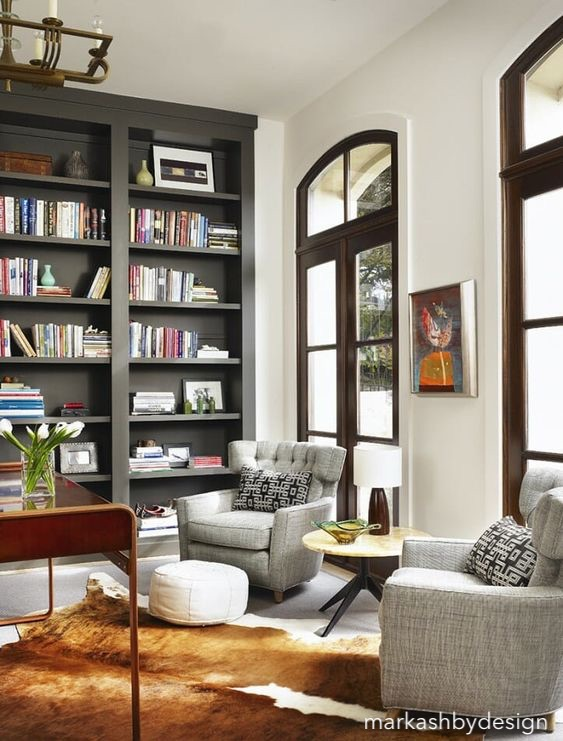 markashbydesign-library-floor-ceiling-bookcases-hide-rug-pair-of-chairs