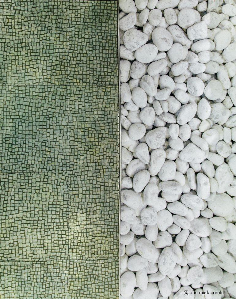 john-mark-arnold-green-tile-flooring-white-pebbles-interior-design