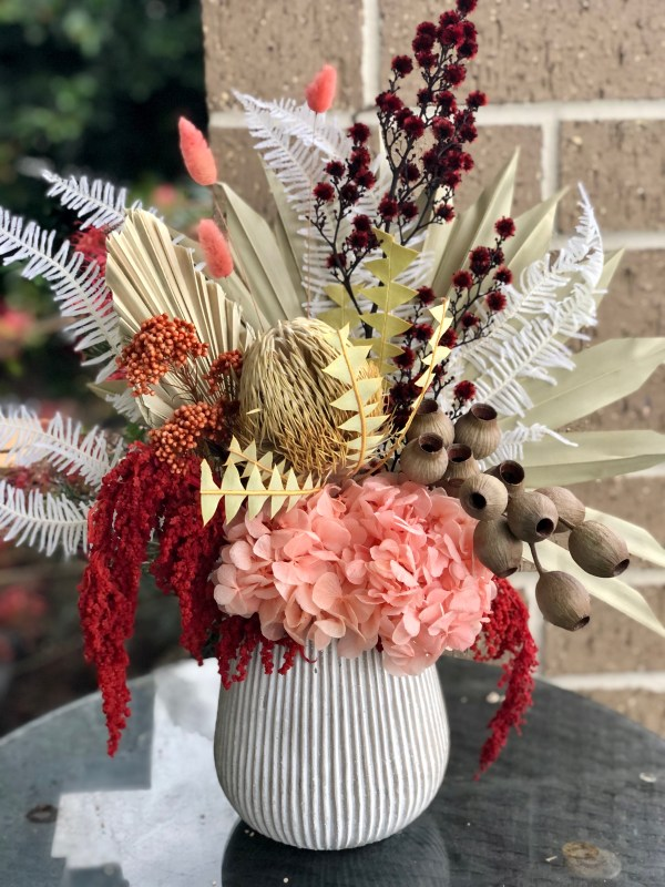 Preserved Peach Hydrangea, Gum nuts, Banksia, Riceflower, Fern, Bunny Tail, Strilingia and Amaranthus