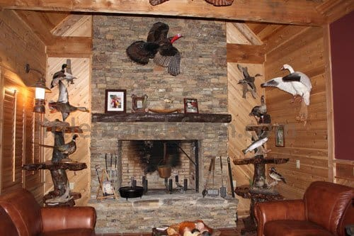 Rustic fireplace mantel on stack stone fireplace