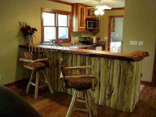 Rustic Kitchen Cabinets Feature Natural Edge Cedar Doors And Redwood Burl  Bar Top.