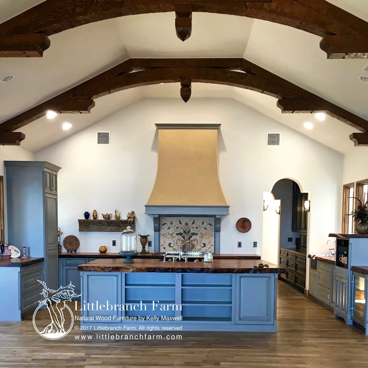Wood countertops on blue cabinets.